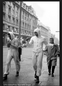 Ali, accompanied by Jimmy Ellis, runs along Regent Street; London 1966
